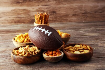Tapeta Chips, salty snacks, football on a table. Great for Bowl Game snack projects.