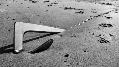 Close-up Of Anchored On Sand
