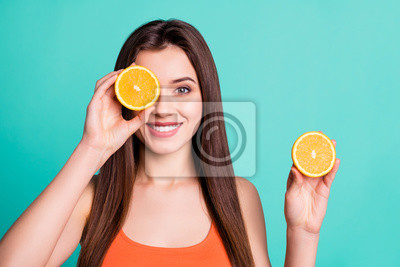 Tapeta Close up photo beautiful amazing her she lady hold arms hide one eye citrus useful slices products advertising nutrition freshness wear casual orange tank-top isolated bright teal turquoise background