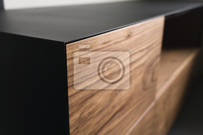 Tapeta Closeup details of modern tv stand made from walnut and powder coated steed