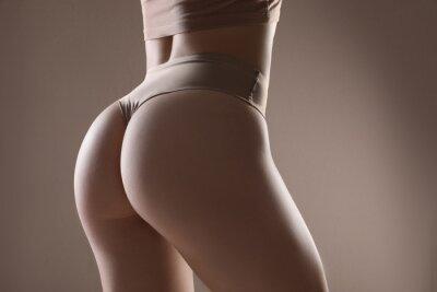 Tapeta Closeup view of slim woman in underwear on beige background. Cellulite problem concept