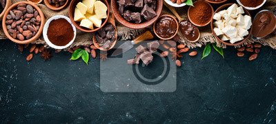 Tapeta Cocoa beans, chocolate, cocoa butter and cocoa powder on a black background. Top view. Free copy space.