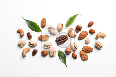Tapeta Composition with organic mixed nuts on white background, top view