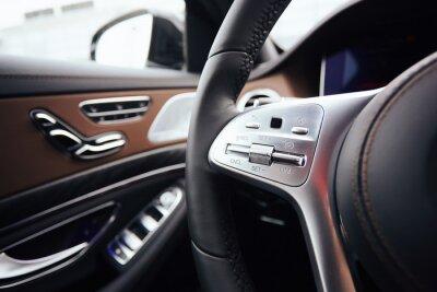 Tapeta Control buttons on steering wheel. Car interior.