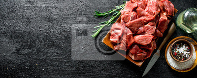 Tapeta Cut raw beef with spices in bowl and rosemary.