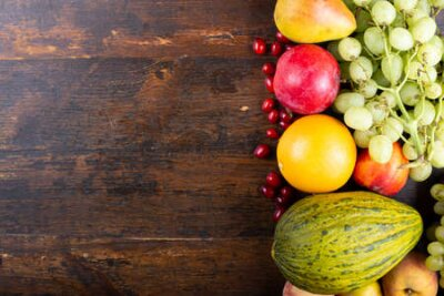 Tapeta different fresh fruit set. on a wooden brown background. place for text