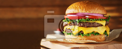Tapeta double cheeseburger with lettuce, tomato, onion, and melted american cheese with panoramic composition