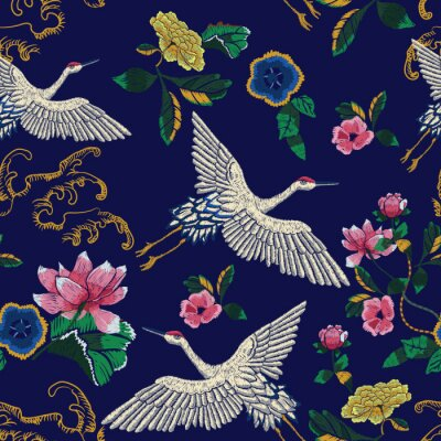 Tapeta Embroidery seamless pattern with oriental cranes, waves and flowers. Vector embroidered floral patch