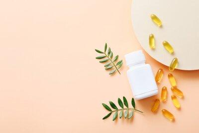 Tapeta Fish oil vitamin capsules on light color background