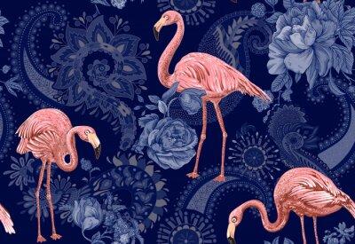 Tapeta Flaming na kolorowym tle. Bezszwowy wzór z flamingami i tropikalnymi roślinami. Kolorowy wzór na tekstylia, okładki, papier pakowy, tkanina