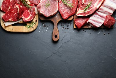 Tapeta Flat lay composition with fresh meat on grey table. Space for text