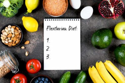 Tapeta Flexitarian Diet Concept. Green vegetables, tomatoes, nuts, fruits, lentils, chickpeas, greens and empty notebook blank on grey concrete table. Flat lay, top view, copy space