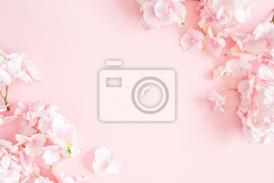 Tapeta Flowers composition. Hydrangea flowers on pastel pink background. Flat lay, top view, copy space