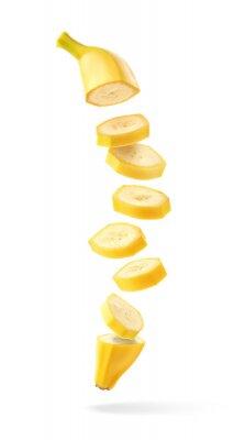 Flying fresh ripe banana slices