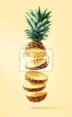Flying fresh ripe pineapple cut into slices
