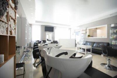 Tapeta Focus on sink for washing hair. Beauty salon inside