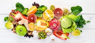 Tapeta Food containing natural vitamin C: Orange, lemon, apple, rose, garlic, broccoli, apple, kiwi, spinach. Top view. On a white background.