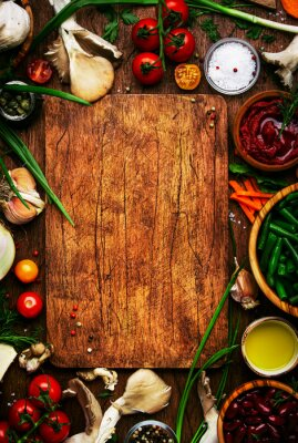 Tapeta Food cooking background, ingredients for preparation vegan dishes, vegetables, roots, spices, mushrooms and herbs. Cutting board. Healthy food concept. Rustic wooden table, top view
