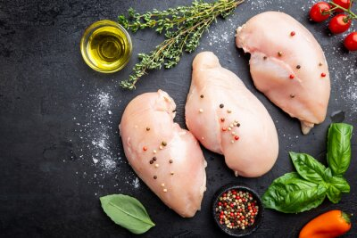 Tapeta Fresh raw chicken breast with herbs and spices, top view. Culinary cooking ingredients