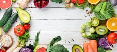Tapeta Fresh vegetables and fruits on a white wooden background. Healthy Organic Food. Top view. Free copy space.