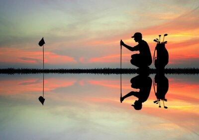Tapeta gracz w golfa na zachodzie słońca