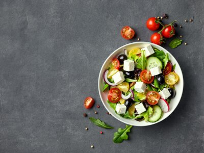 Tapeta Greek salad with fresh vegetables, feta cheese and black olives