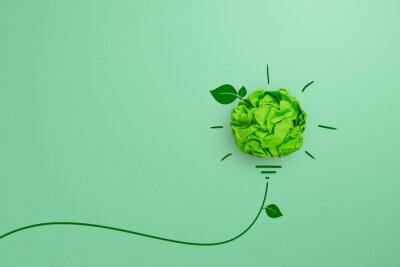 Tapeta Green crumpled paper light bulb on green background, Corporate Social Responsibility (CSR), eco-friendly business and environmental concept