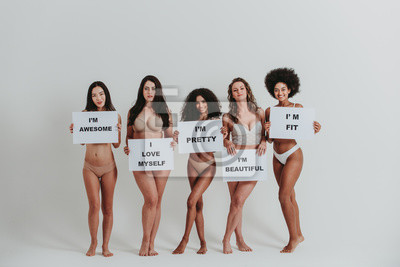 Tapeta Group of women with different body and ethnicity posing together to show the woman power and strength. Curvy and skinny kind of female body concept