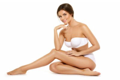 Tapeta Happy woman with a beautiful body isolated on white background