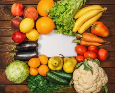 Tapeta Healthy Organic Food background with Copy Space. Vegan or Vegetarian Food, Raw Vegetables and Fruits on wooden table, Top View.