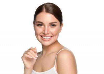 Tapeta Healthy teeth smile woman clean skin natural makeup female portrait over gray background. Studio shot.