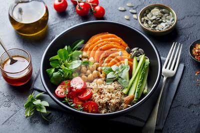 Tapeta Healthy vegetarian salad. Roasted pumpkin, quinoa, tomatoes, green salad. Buddha bowl. Slate background. Close up.