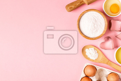 Tapeta Ingredients and utensils for baking on a pastel background.