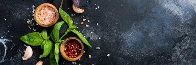 Tapeta Ingredients for making traditional italian pesto sauce on old dark rustic background. Flat lay