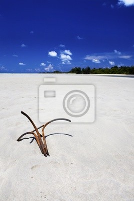 Kotwica w piasku.