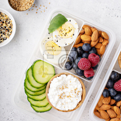 Tapeta Lunch or snack box with high protein food, cottage cheese, nuts and eggs