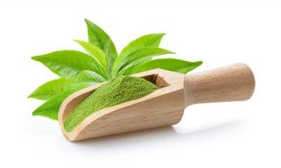 Tapeta matcha green tea powder in wood scoop and leaf on white