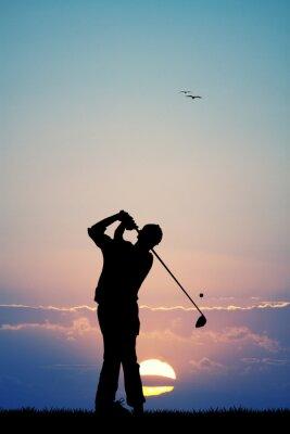 Tapeta Mężczyźni grają w golfa o zachodzie słońca