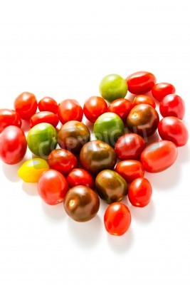 Multicolored cherry tomatoes picked from organic garden.
