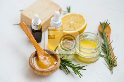 Tapeta Natural skincare ingredients with manuka honey, lemon, essential oil, clay, balm, rosemary herbs and natural soap, healthy wellness and spa products , natural homemade ingredients