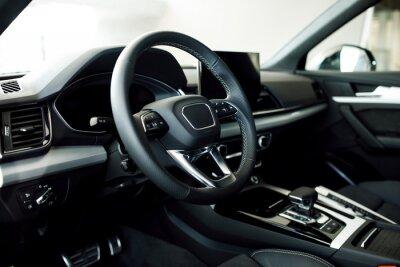 Tapeta New modern car close up. Car detailing or Interior detail.