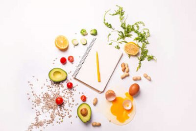 Tapeta Notebook with healthy products on white background. Diet concept