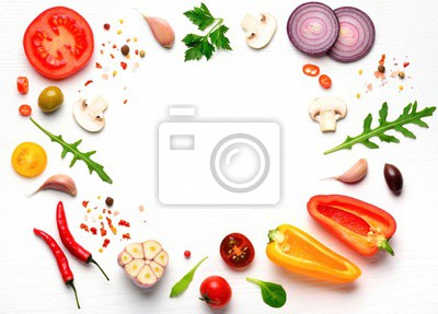 Tapeta Organic fresh vegetables and spices frame on wooden white background. Copyspace, top view.
