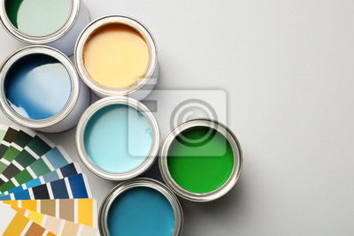 Tapeta Paint cans and color palette on white background, top view. Space for text