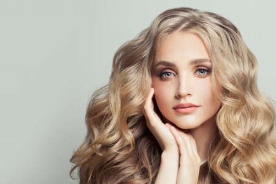 Tapeta Perfect blonde woman with long healthy curly hair
