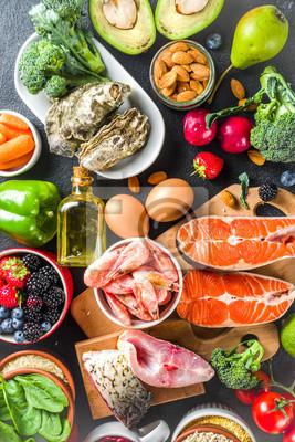 Tapeta Pescetarian diet plan ingredients, healthy balanced grocery food, fresh fruit, berries, fish and shellfish clams,  black background copy space