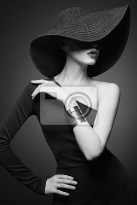 Tapeta portrait of young lady with black hat and evening dress