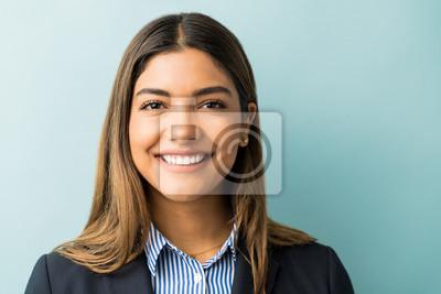 Tapeta Pretty Hispanic Businesswoman Smiling In Studio
