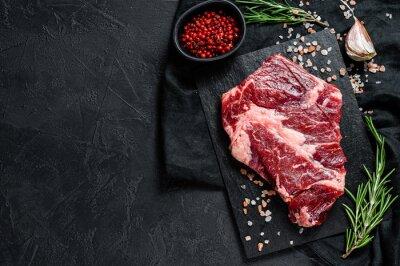 Tapeta Raw beef fillet steak. Organic farm meat. Black background.