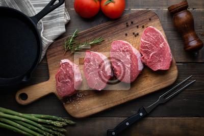 Tapeta raw beef tenderloin on wooden cutting board